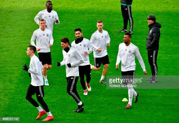 Germany's head coach Joachim Loew watches his players during a training session on the eve of the friendly football match Germany vs Brazil in Berlin...