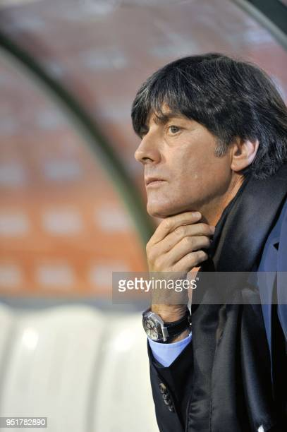 Germany's head coach Joachim Low lokks at hios players before the first qualification match for the Euro 2012 soccer championship between Belgium and...