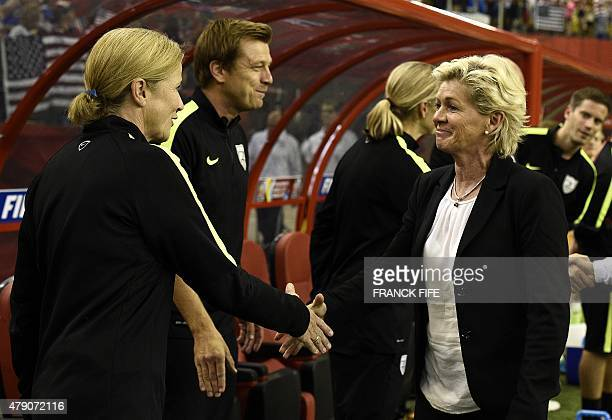 Germany's head coach Silvia Neid shakes hands with USA head coach Jill Ellis during the semifinal football match between USA and Germany during their...