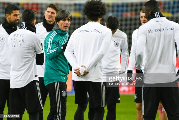 Germany's headcoach Joachim Loew talks to the players during a training session of the German team ahead of their international friendly match...