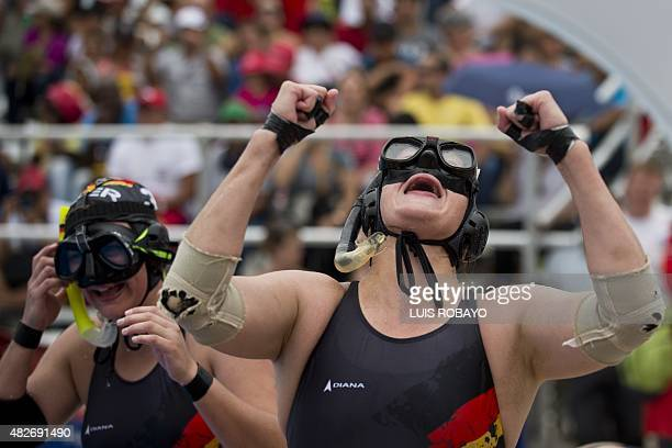 Germany's Heide Bohm celebrates after defeating Norway in their 10th CMAS Underwater Rugby World Championship final match at the Alberto Galindo...