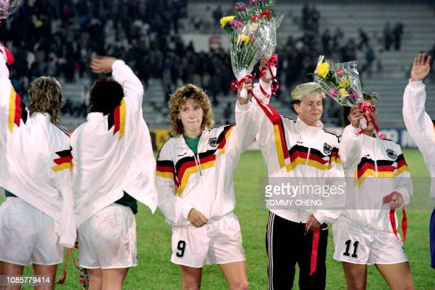 Germany's Heidi Mohr and her teamate salute the 67000strong audience during the medal presentation ceremony of the first FIFA World Championship for...