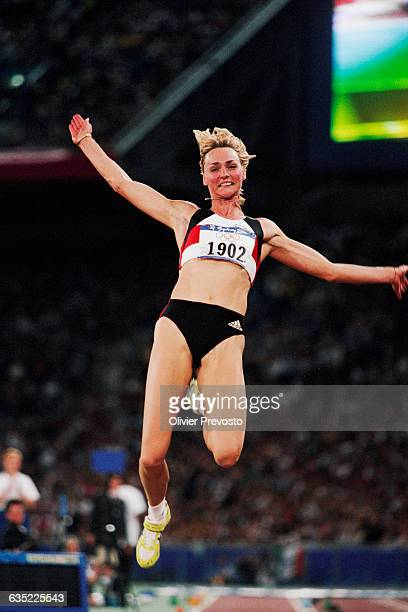 Germany's Heike Drechsler jumps in the women's long jump competition of the 2000 Olympics