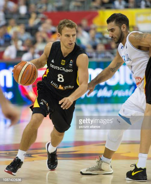 Germany's Heiko Schaffartzik and Italy's Pietro Aradori in action during the FIBA EuroBasket 2015 Group B match Italy vs Germany in Berlin Germany 09...