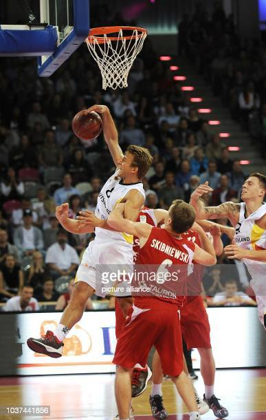 Germany's Heiko Schaffartzik goes up against Poland's Robert Skibniewski  during the European Basketball Championships qualification match between...