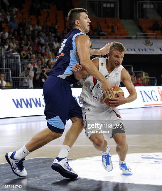 Germany's Heiko Schaffartzik in action against BosniaHerzegovina's Andrija Stipanovic during the Basketball DBB Supercup match between Germany and...