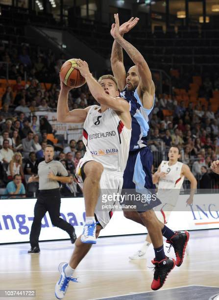 Germany's Heiko Schaffartzik in action against BosniaHerzegovina's Zach Wright during the Basketball DBB Supercup match between Germany and Bosnia...
