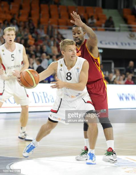 Germany's Heiko Schaffartzik in action against Macedonia's Bo McCalebb during the Basketball DBB Supercup match between Germany and Macedonia at the...