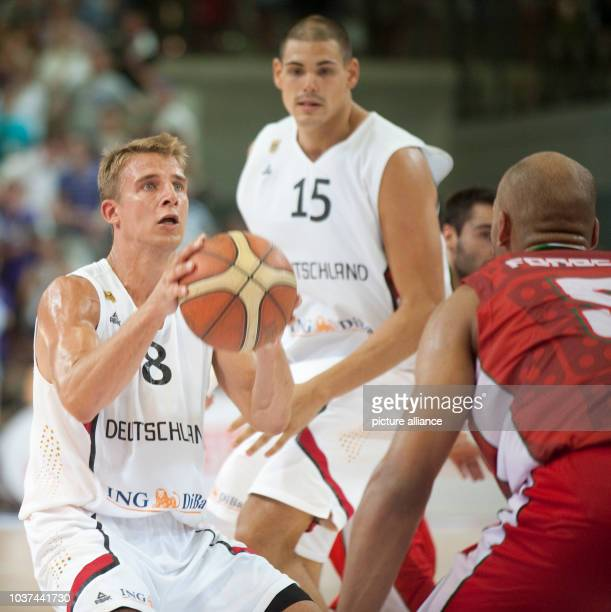 Germany's Heiko Schaffartzik plays against Portugal's Claudio Fonseca during the international basketball match Germany vs Portugal at SArena in...