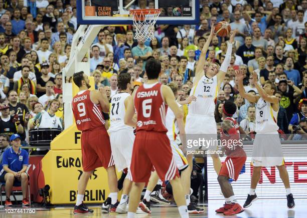 Germany's Heiko Schaffartzik Robin Benzing and Tibor Pleiss and Turkey's Semih Erden and Cedi Osman in action during the FIBA EuroBasket 2015 Group B...
