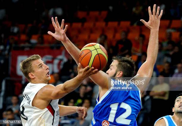 Germany's Heiko Schaffartzik vies for the ball with Greece's Ian Vougioukas during the Basketball Supercup match between Germany and Greece at...