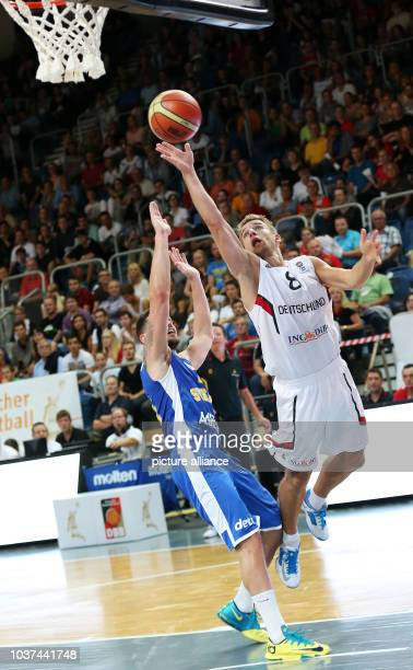 Germany's Heiko Schaffartzik vies for the ball with Sweden's Kenny Grant during the international basketball match between Germany and Sweden at...