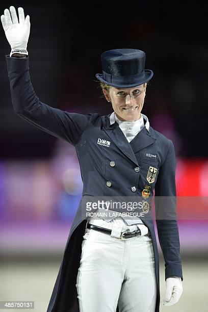 Germany's Helen Langehanenberg celebratesa on the podium after the Reem Acra FEI World Cup dressage final at the Eurexpo Hall in Chassieu near Lyon...