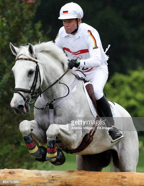 Germany's Hinrich Romeike on Marius at the water jump at fence 5/6 takes part in the cross country section of the Three Day Eventing held at the...