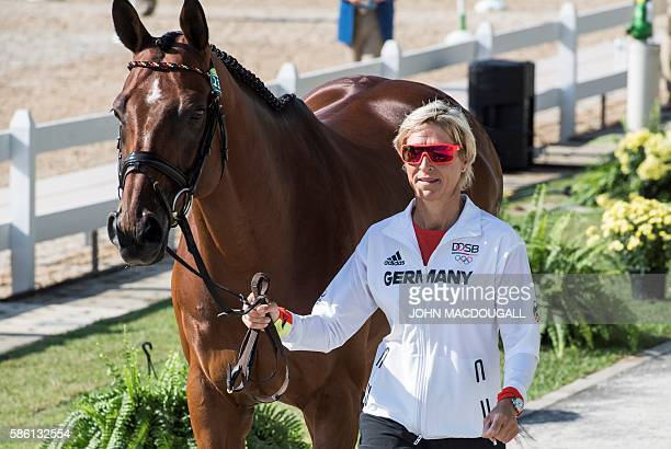 Germany's Ingrid Klimke leads HaleBob Old to a trot during the first horse inspection of the Equestrian's Eventing phase during the 2016 Rio Olympic...