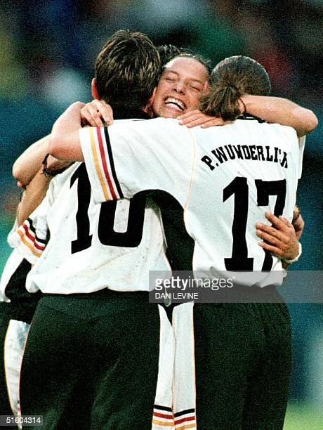 Germany's Inka Grings is mobbed by teammates Bettina Wiegmann and Pia Wunderlich after Grings' first goal of the game against Mexico during the first...