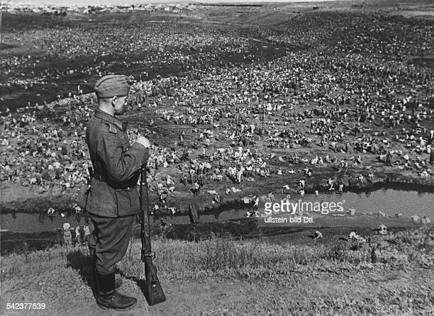 Germany's invasion of the Soviet Union German soldier is guarding captured Soviet soldiers after the Battle of Uman / Ukraine August / September 1941...