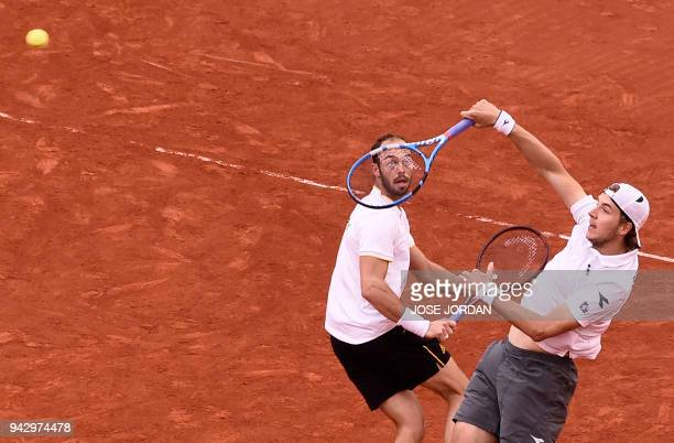 TOPSHOT Germany's JanLennard Struff and Germany's Tim Puetz return the ball during the Davis Cup quarterfinal doubles tennis match against Spain's...