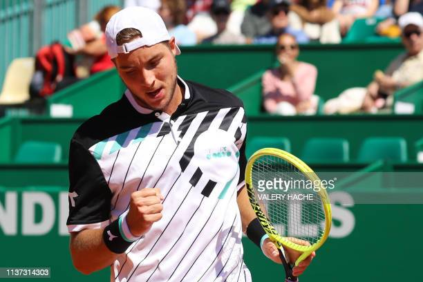 Germany's JanLennard Struff celebrates after scoring a point against Canada's Denis Shapovalov during their tennis match on the day 3 of the...