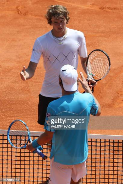 Germany's Jan-Lennard Struff congratulates Germany's Alexander Zverev at the end of their tennis match during the Monte-Carlo ATP Masters Series...