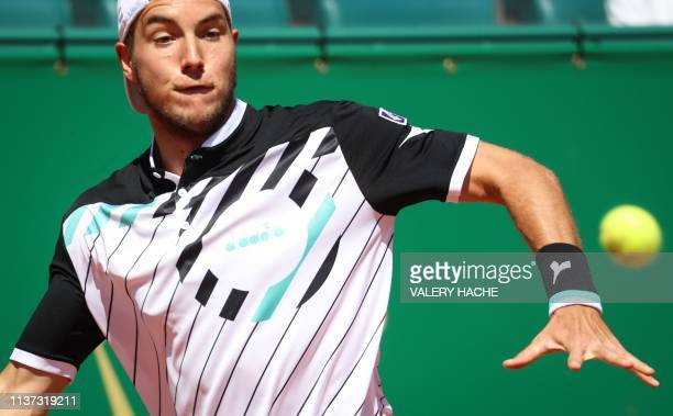 Germany's JanLennard Struff eyes the ball before playing a return to Canada's Denis Shapovalov during their tennis match on the day 3 of the...