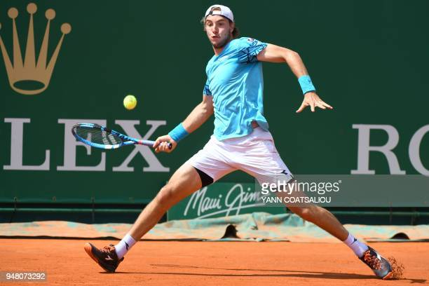 TOPSHOT Germany's JanLennard Struff hits a return to Italy's Fabio Fognini during their men's single match at the MonteCarlo ATP Masters Series...