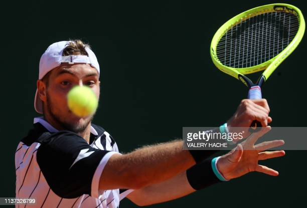 Germany's JanLennard Struff plays a backhand return to Canada's Denis Shapovalov during their tennis match on the day 3 of the MonteCarlo ATP Masters...