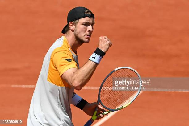 Germany's Jan-Lennard Struff reacts during his quarter-final match against Serbia's Filip Krajinovic at the ATP Tennis BMW Open in Munich, southern...