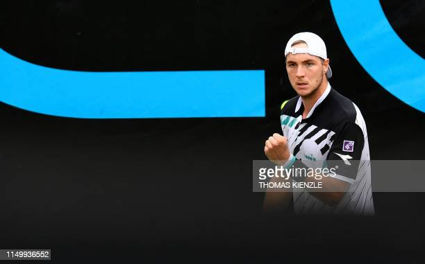 Germany's JanLennard Struff reacts in his quarterfinal match against France's Lucas Pouille at the ATP Mercedes Cup tennis tournament in Stuttgart...