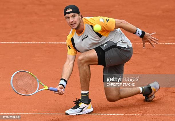 Germany's Jan-Lennard Struff returns the ball to Germany's Dominik Koepfer during their match of the ATP Tennis BMW Open in Munich, southern Germany,...
