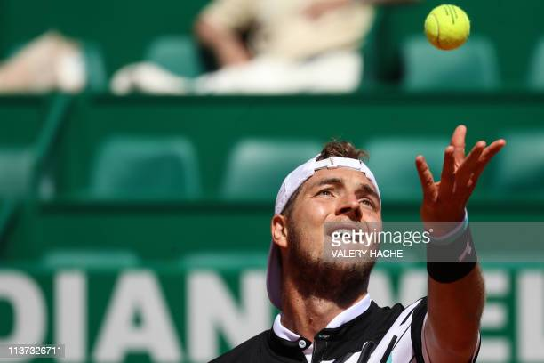 Germany's JanLennard Struff serves against Canada's Denis Shapovalov during their tennis match on the day 3 of the MonteCarlo ATP Masters Series...
