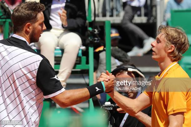 Germany's JanLennard Struff shakes hands with Canada's Denis Shapovalov after winning their tennis match on the day 3 of the MonteCarlo ATP Masters...