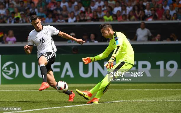 Germany's Janni Serra and Italy's goalkeeper Alex Meret vie for the ball during the UEFA European Under19 Championship group stage soccer match...