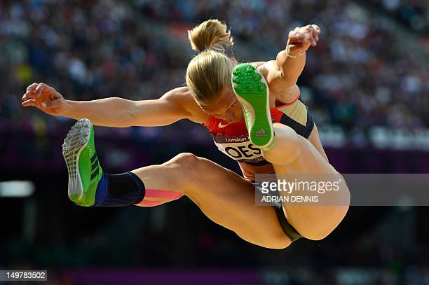 Germany's Jennifer Oeser competes in the women's heptathlon long jump qualifications at the athletics event of the London 2012 Olympic Games on...