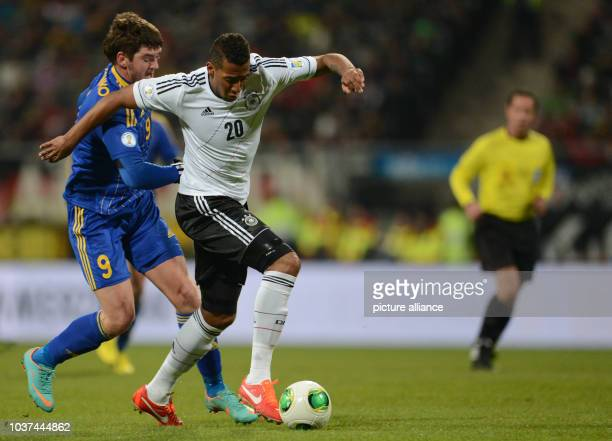 Germany's Jerome Boateng and Kazakhstan's Sergey Ostapenko vie for the ball during the FIFA World Cup 2014 qualification group C soccer match between...