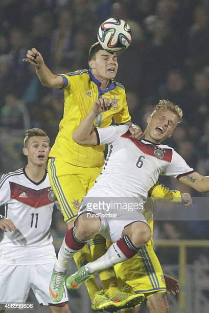 Germany's Johannes Geis in action against Maksym Malyshev of Ukraine during the UEFA U21 Championship First Leg Playoff between Ukraine and Germany...