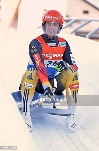 Germany's Johannes Ludwig reacts after placing second at the men's singles event of the Luge World Cup in Sigulda Latvia on January 26 2014 Italy's...