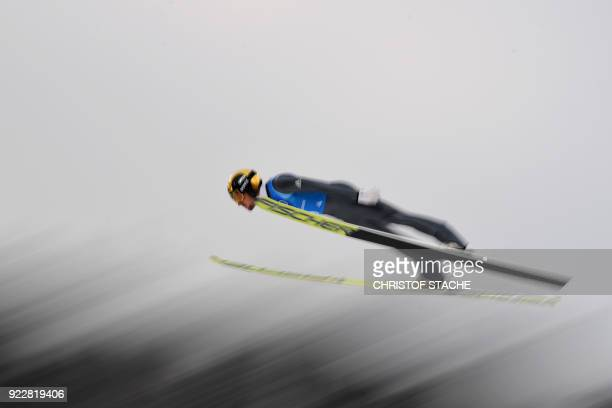 Germany's Johannes Rydzek competes in the nordic combined men's team Gundersen LH/4x5km Jumping competition at the Alpensia ski jump centre during...