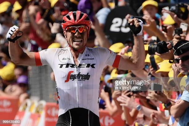 Germany's John Degenkolb celebrates as he crosses the finish line to win the ninth stage of the 105th edition of the Tour de France cycling race...