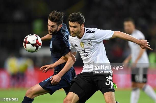 Germany's Jonas Hector and England's Adam Lallana vie for the ball during the international match between Germany and England at Signal Iduna Park in...