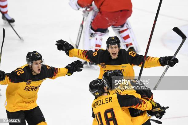 Germany's Jonas Muller is congratulated by teammates after scoring in the men's gold medal ice hockey match between the Olympic Athletes from Russia...