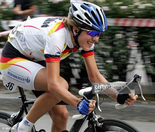 Germany's Judith Arndt rides to win the women elite road race of the 2004 UCI road world championships 02 October 2004 in Verona Arndt won the event...