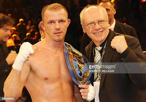 Germany's Juergen Braehmer celebrates winning the EBU lightheavyweight European Championship boxing match against Rachid Kanfouah of France with...