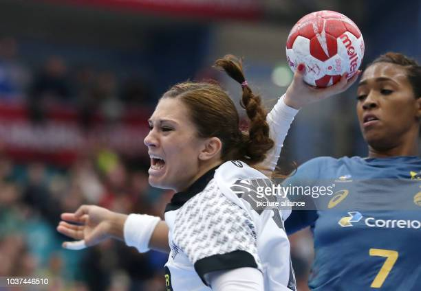 Germany's Julia Behnke gets past Brazil's Tamires Araujo during the women's handball match between Germany and Brazil in Kolding, Denmark, 8 December...
