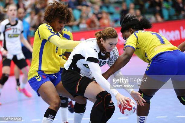 Germany's Julia Behnke in action against the Congo's Christianne Mwange Mwasesa and Apopie Lusamba Puna during a handball match between Germany and...