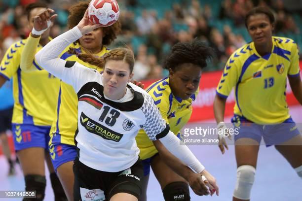 Germany's Julia Behnke in action against the Congo's Mwange Mwasesa Lydia Musonda Kasangala and Apopie Lusamba Puna during a handball match between...