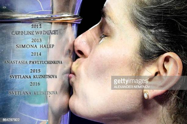 Germany's Julia Goerges kisses the trophy as she celebrates after her victory over Russia's Daria Kasatkina in the Kremlin Cup tennis tournament...