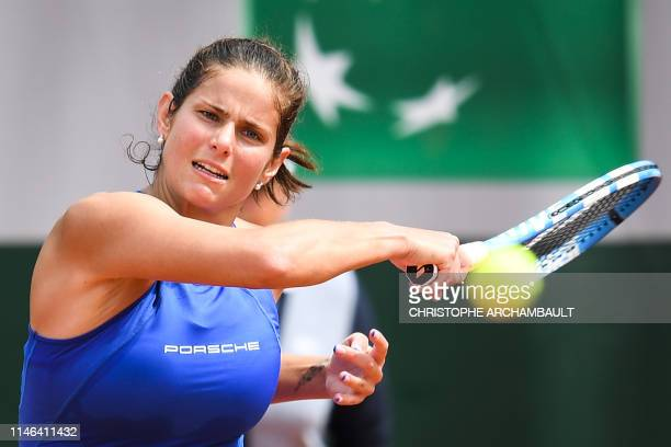 Germany's Julia Goerges plays a backhand return to Estonia's Kaia Kanepi during their women's singles first round match on day two of The Roland...
