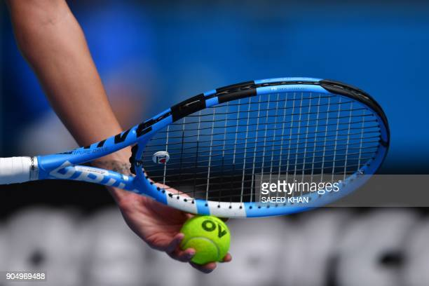 Germany's Julia Goerges prepares to serve against Sofia Kenin of the US during their women's singles first round match on day one of the Australian...