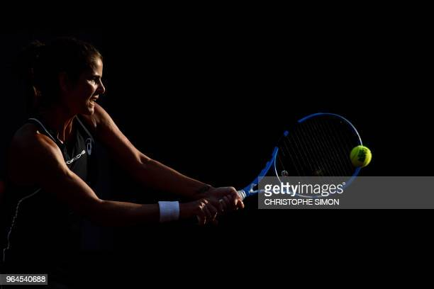 Germany's Julia Goerges returns the ball to Belgium's Alison Van Uytvanck during their women's singles second round match on day five of The Roland...